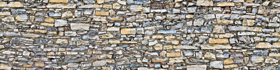 Fototapeta Struktura ściany Rough stone wall in poster size