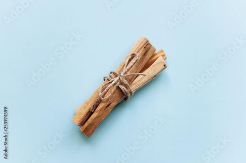 Fotografía  A set of wooden sticks Palo Santo on a blue background