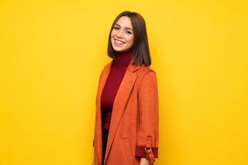Young woman with coat smiling