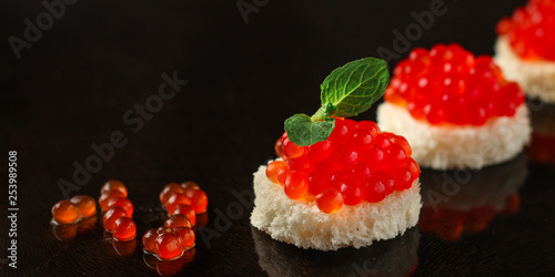 Photo sur Aluminium Roe red caviar (sandwich with red snack - buffet) salmon fish, seafood. food background. top view.