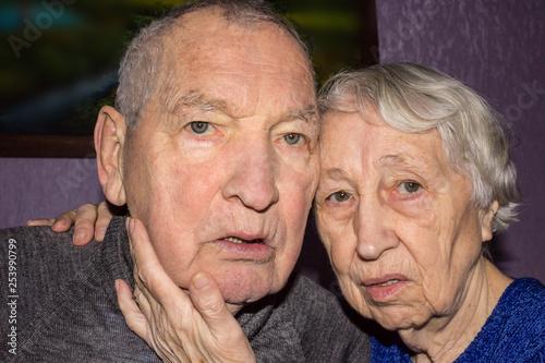 Fototapety, obrazy: Portrait of a sad elder couple at home