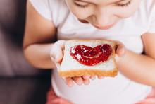 Children Hand's Holding Sandwich With Jam
