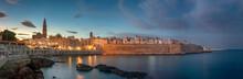 Sunset Panorama Of Monopoli Harbor In The Metropolitan City Of Bari And Region Of Apulia ( Puglia ) , Italy And Beautiful Illuminated Cathedral Basilica Concattedrale Maria Santissima Della Madia