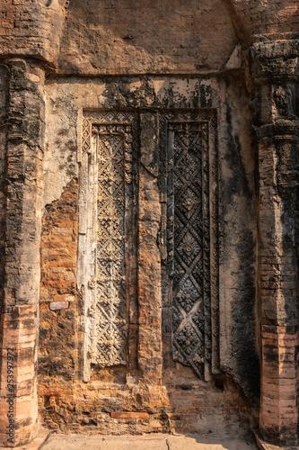 Preah ko temple cambodia: false door to sanctuary with carvings
