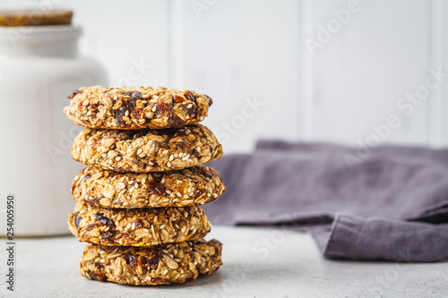 Valokuva  Stack of oatmeal cookies with dates. Healthy dessert concept.