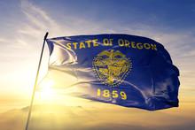 Oregon State Of United States Flag Waving On The Top Sunrise Mist Fog