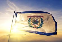 West Virginia State Of United States Flag Waving On The Top Sunrise Mist Fog