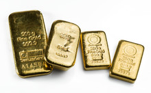 Four A Cast Gold Bars Of Different Weight Isolated On White Background.