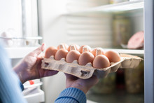 Woman Hands Take Eggs From The Fridge