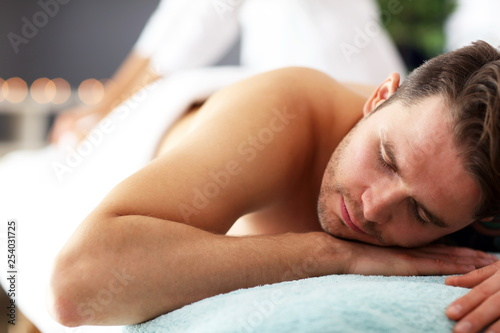 Fotobehang Ontspanning Handsome man having massage in spa salon