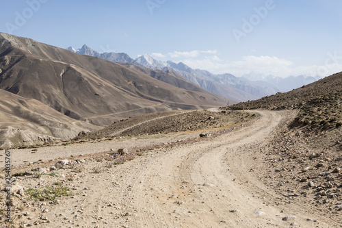 Pamir Highway in the desert landscape of the Pamir Mountains in Tajikistan Canvas Print