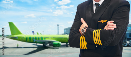 passenger air service. Pilot in front of plane in airport Canvas