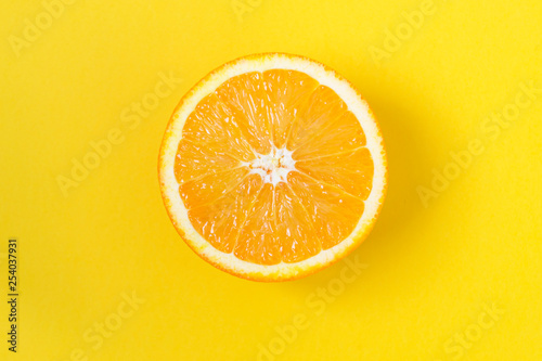 Photo Stands Slices of fruit Orange slice along, on a yellow background.