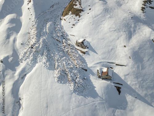 Obraz na płótnie Aerial view of snow avalanche on mountain slope