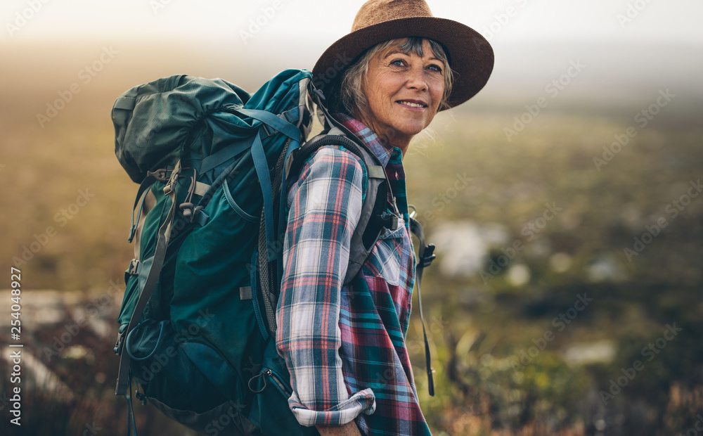 Fototapety, obrazy: Portrait of a woman hiker