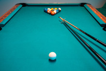 Billiard Balls And A Pool Table. A Vintage Style Photo Of A Billiard Balls On A Pool Table With A Cue Stick.