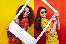 Beautiful Women Holding A Blank Photo Frame