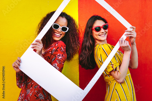 Photo sur Toile Pain Beautiful women holding a blank photo frame