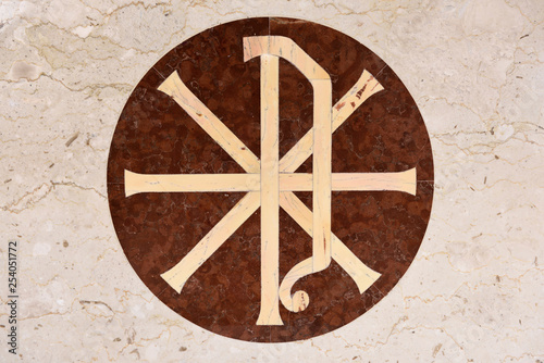Fotografering  Christian Chi Rho PX symbol for first two Greek letters of Christ on inlaid marb