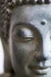 Buddha face close up shot. Buddhist religion concept idea