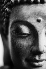 Black And White Photo Of A Buddha Face Close Up Shot. Buddhist Religion Concept Idea