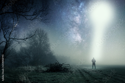 Türaufkleber UFO A lone hooded figure standing on a path on a spooky misty night, with a cold blue edit.
