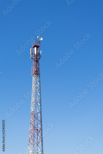 Fotografie, Tablou  Antenna tower with blue sky and cloud background.