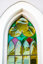 Multicolored Stained Glass Window Gothic Style. Catholic Church In The Gothic Style