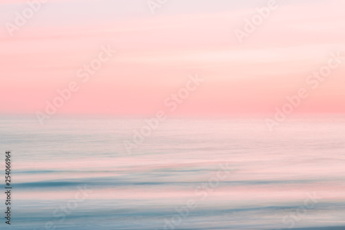 Poster Mer coucher du soleil Abstract blurred sunrise sky and ocean nature background