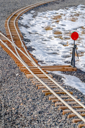Fotografie, Obraz  Railroad switch on a railroad junction in winter