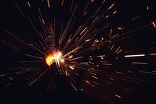 Arc Welding. Welding Of Two Metal Plates In Inert Gases. MIG / MAG. A Bright Flash Of Light And A Sheaf Of Sparks.