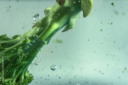 Poster Spa Green Broccoli on water with water bubbles
