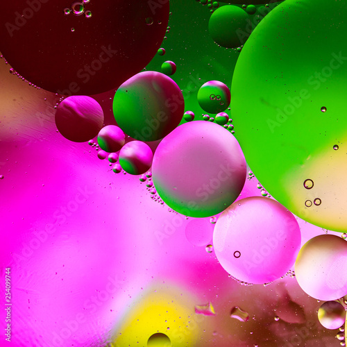 Air bubbles on the surface of an oily liquid. Can be used as a poster or background for design.