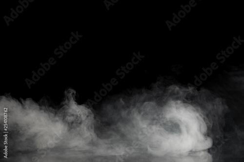 Fotografiet  Abstract Smoke on black Background