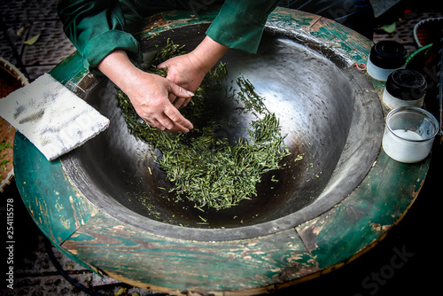 Aluminium Prints Mills Traditional tea making Drying green tea in pan processing by hand at Longjing Village in Hangzhou China.