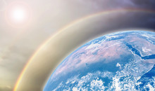 Celebration Of Earth Day With Beautiful Mother Earth Protect Heat Wave From The Sun By Ozone Layer Background.Earth Image Furnished By NASA.