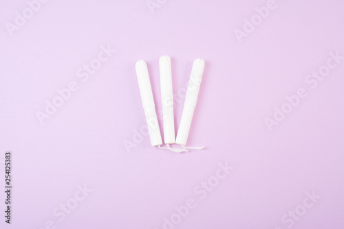 Menstrual tampons isolated on pink background. Space for text. Canvas Print