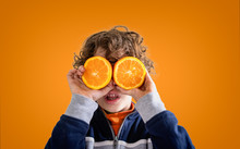 Cute Kid Playing With Orange F...