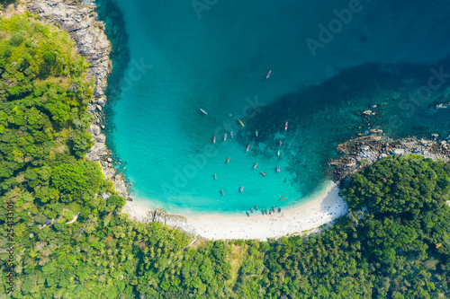 Valokuvatapetti View from above, stunning aerial view of a beautiful tropical beach with white sand and turquoise clear water, long-tail boats and people sunbathing, Freedom beach, Phuket, Thailand