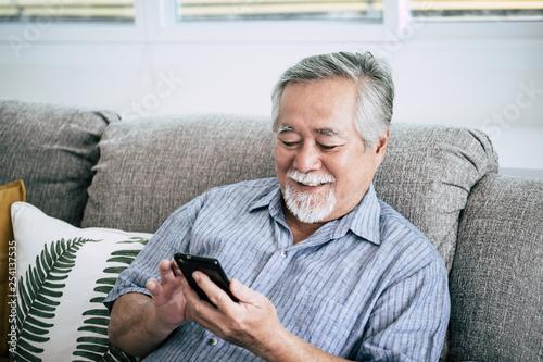 Fotografie, Obraz  Senior Man Using Smart phone