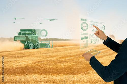 Aufkleber - Farmer controls autonomous harvester.