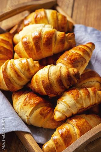 Obraz na plátně Homemade butter croissants on wooden tray.