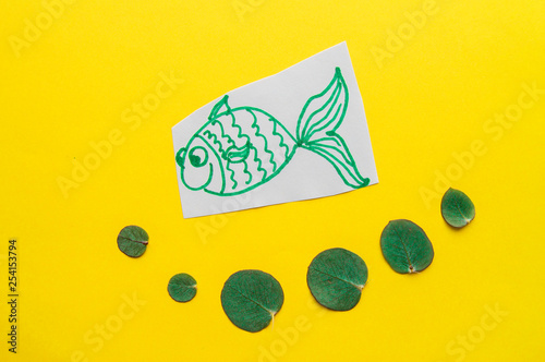 Fotografie, Obraz  Funny fish with bubbles on yellow background, april Fool's day