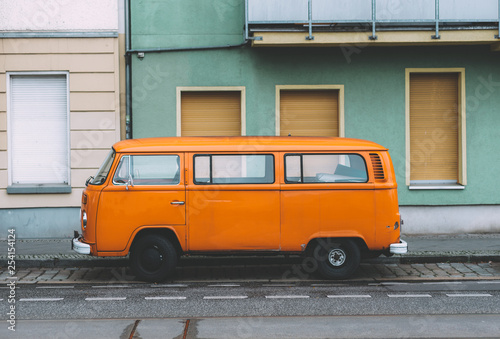 Parked orange VW van Fotobehang