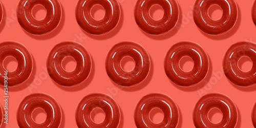 Creative pattern donuts flat lay on pastel coral background