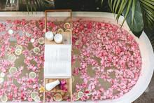 Bath Tub With Flowers And Lemo...