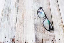 Black Glasses On Wooden Backgr...