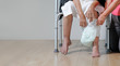 elderly woman changing diaper with caregiver