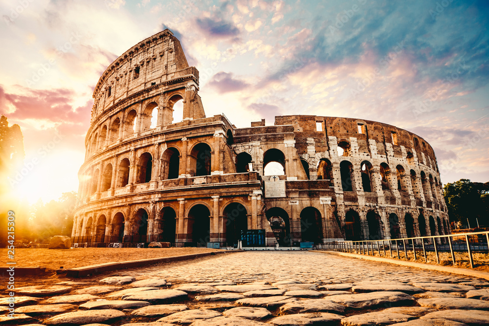 Fototapeta The ancient Colosseum in Rome at sunset