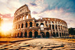 canvas print picture - The ancient Colosseum in Rome at sunset